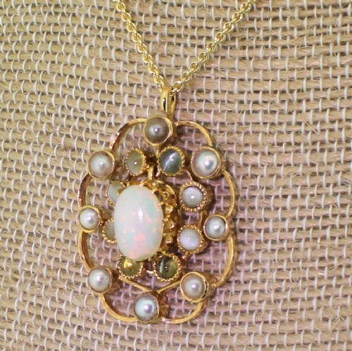 art deco opal natural pearl cats eye pendant circa 1930