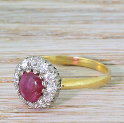 mid century 065 carat cabochon ruby old cut diamond cluster ring circa 1950