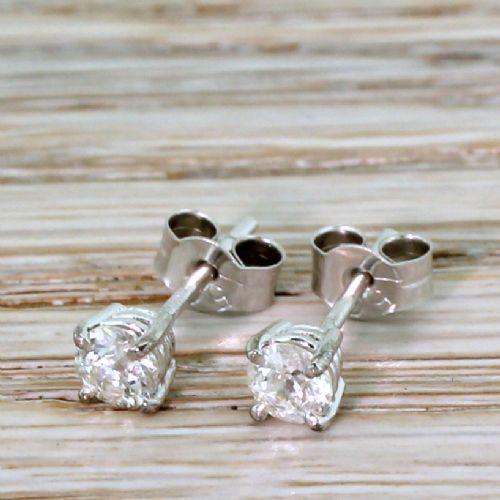 048 carat old cut diamond stud earrings 18k white gold