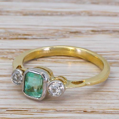 mid century 087 carat emerald 022 carat diamond ring circa 1950