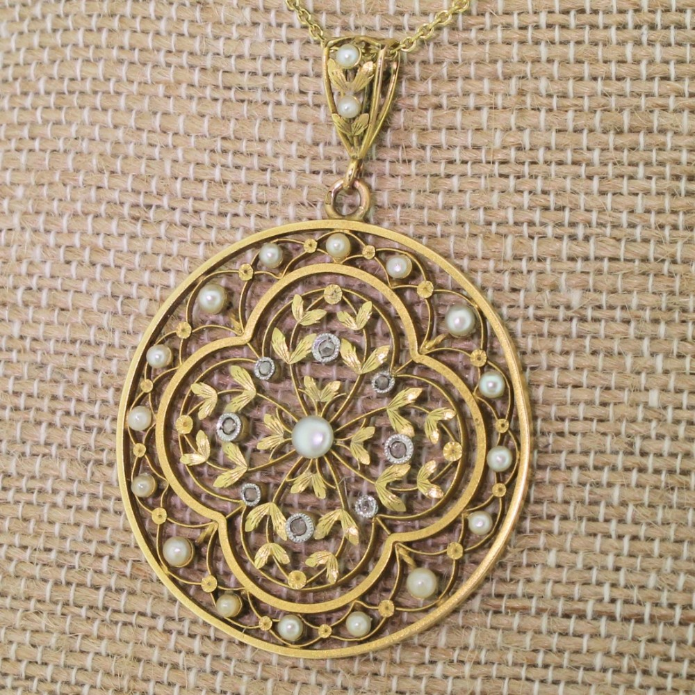 art nouveau natural seed pearl rose cut diamond pendant circa 1900