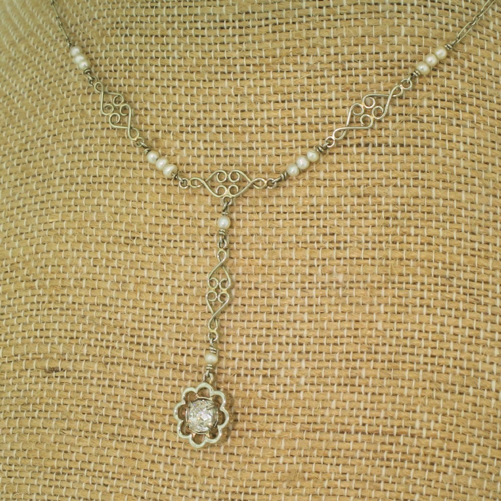 mid century 065 carat old cut diamond seed pearl necklace circa 1950