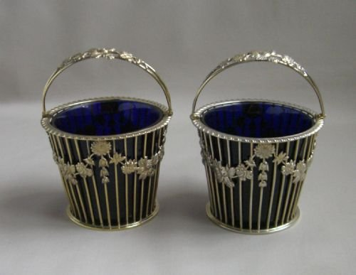 pair silvergilt asprey sugar baskets