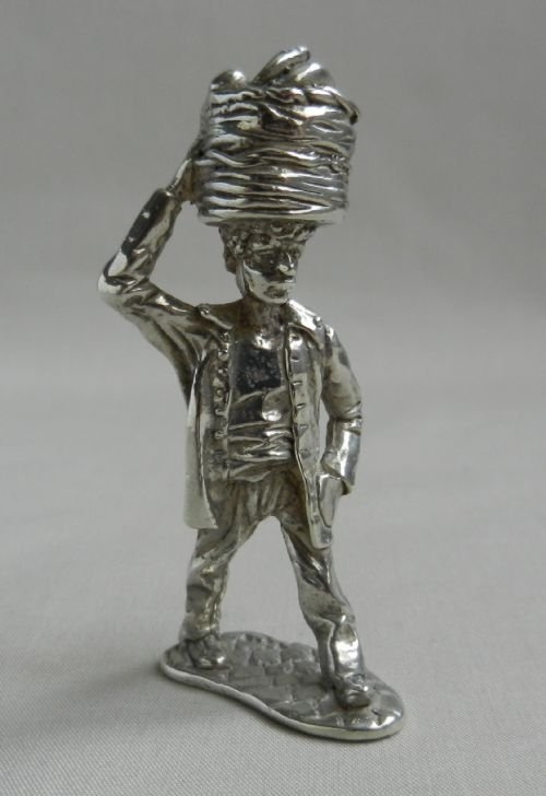 silver fruit porter figure