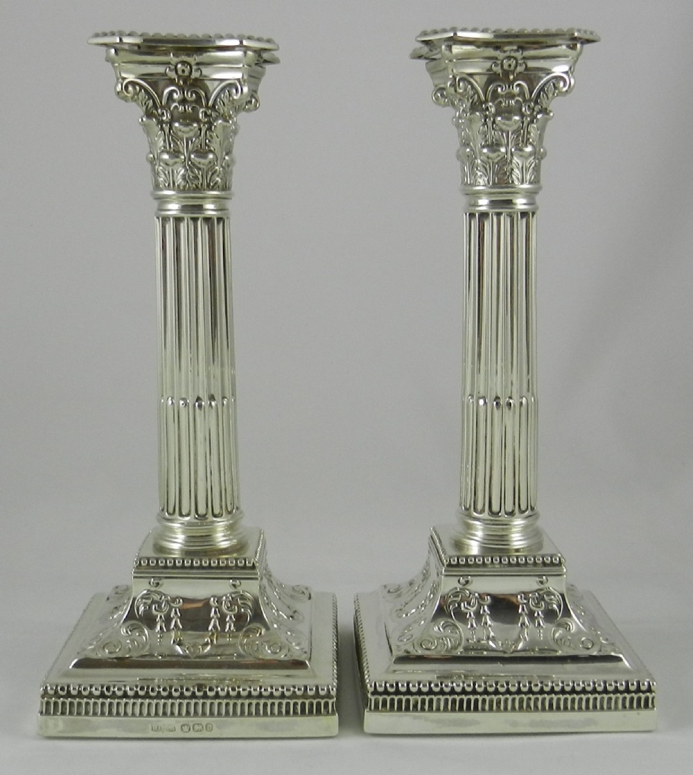pair antique silver candlesticks