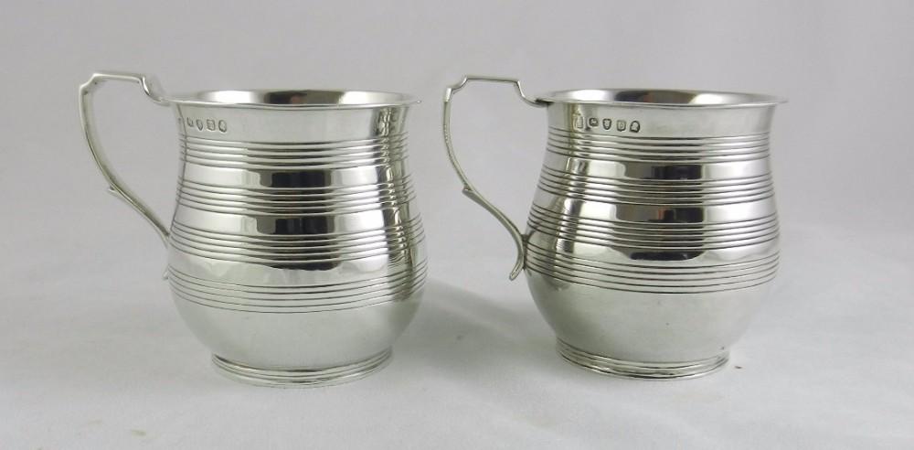 pair geo iii silver mugs