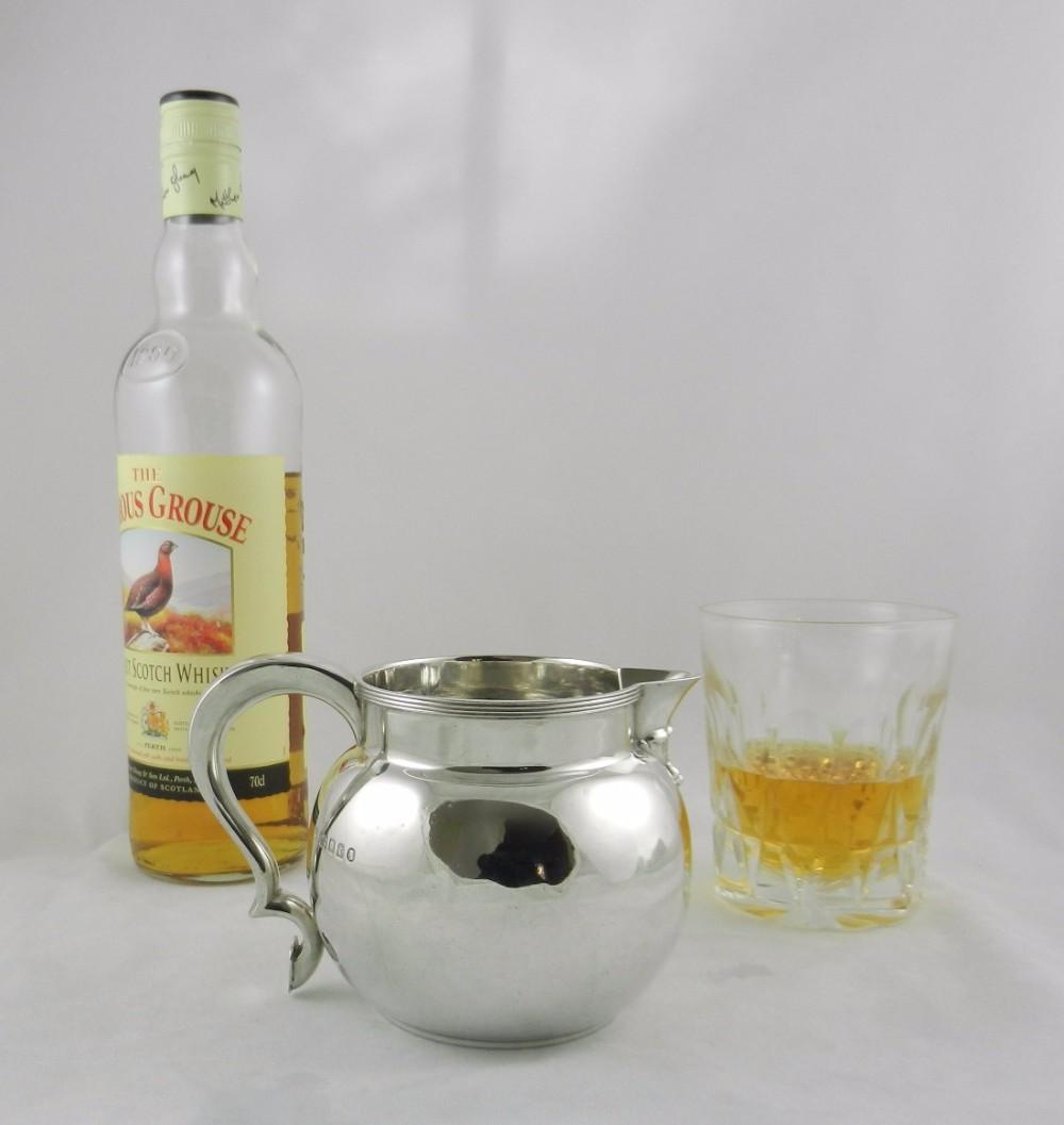 silver whisky water jug