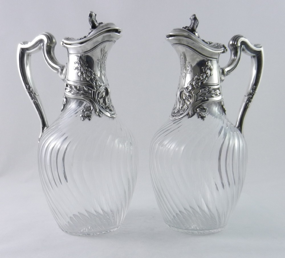 pair antique silvermounted claret jugs