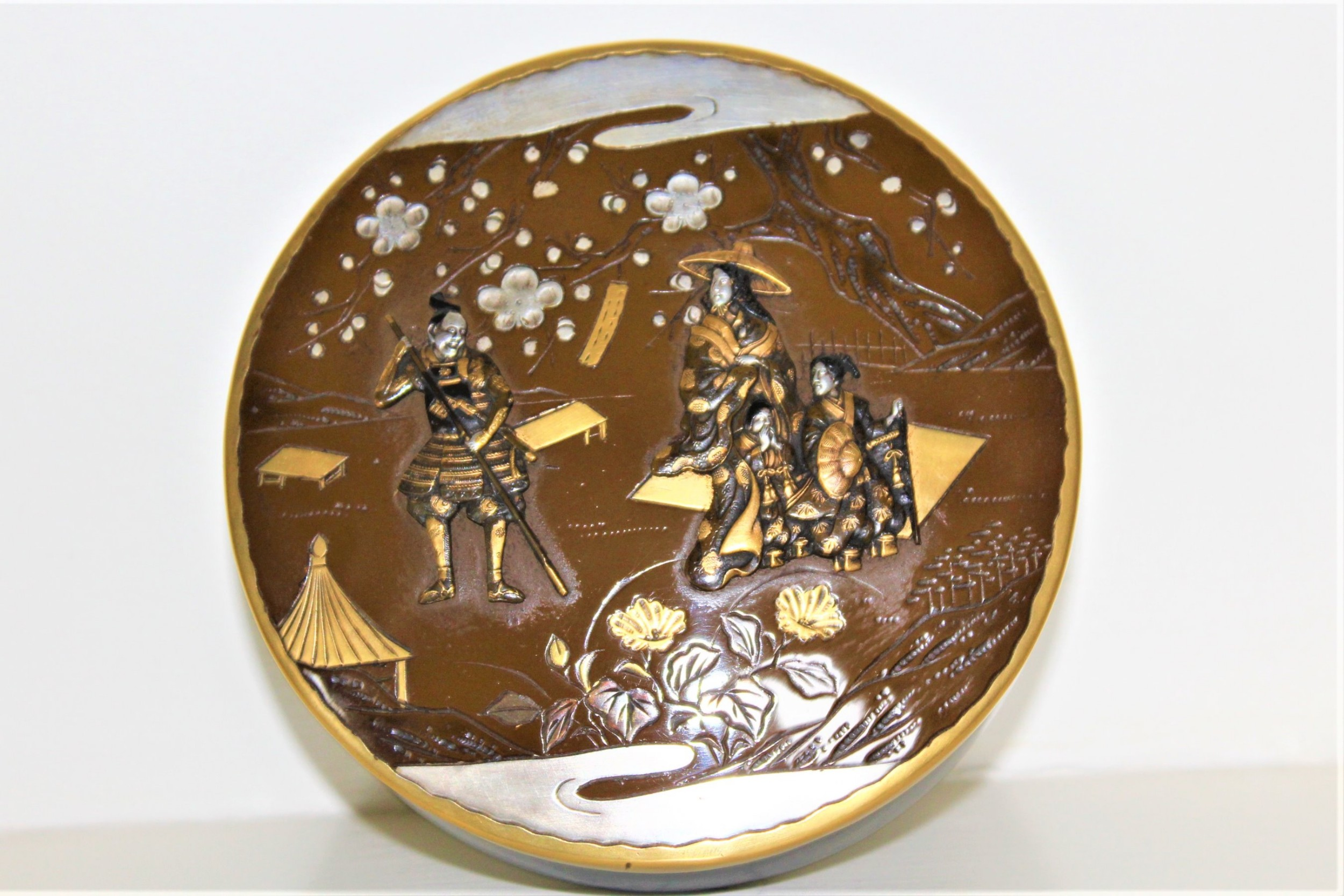 a fine large japanese circular bronze box the lid is finely worked with mixed metal of silver gold and bronze