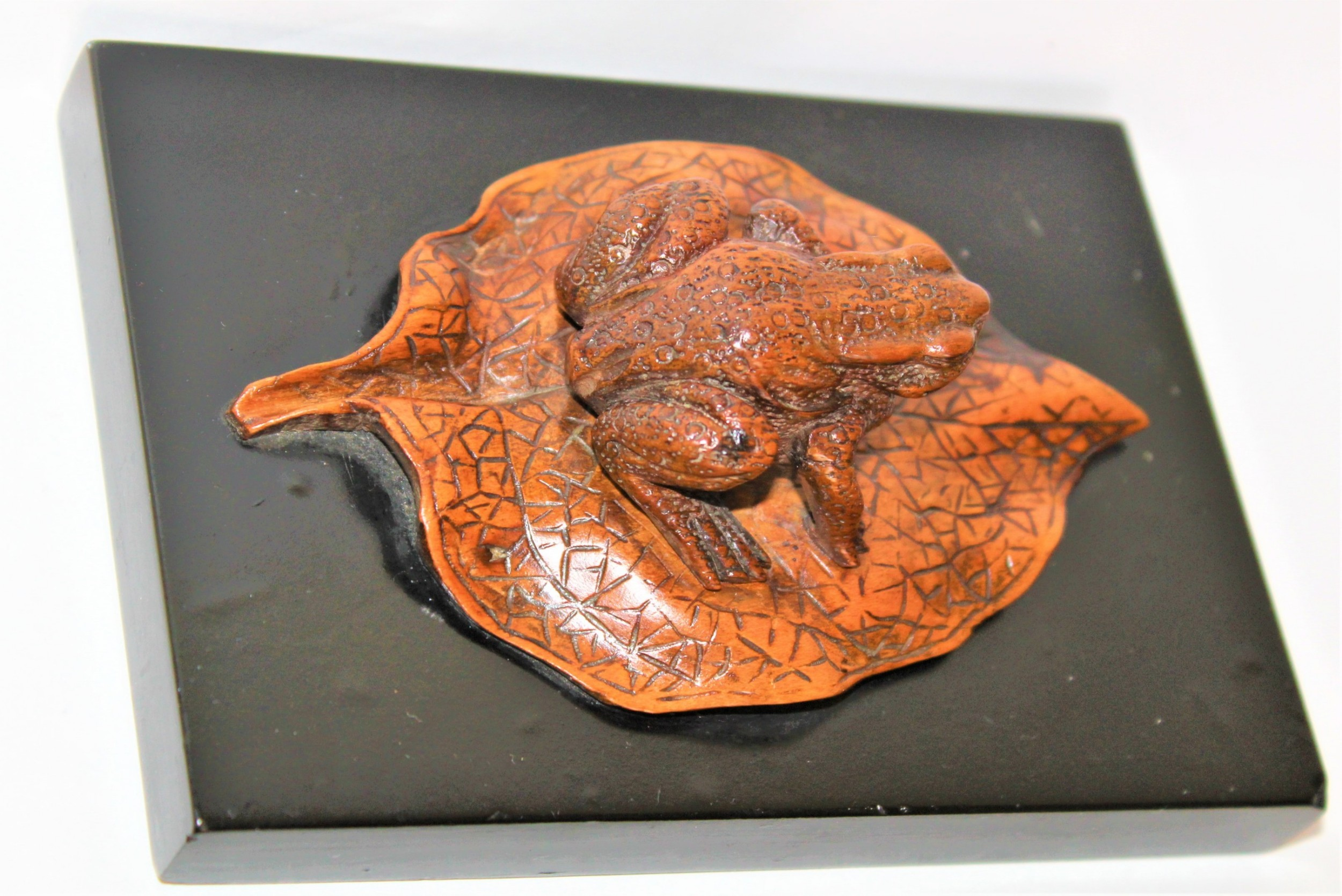 a charming and well carved japanese boxwood paper weight of a toad