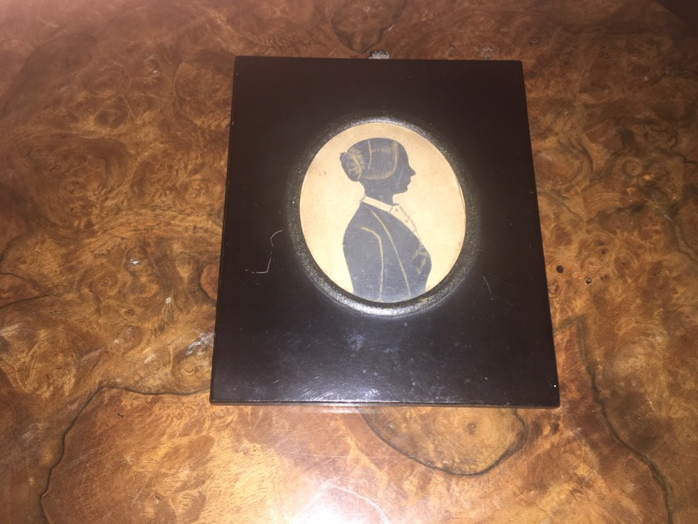 early 19th century silhouette of a victorian lady heightened with gilt paint