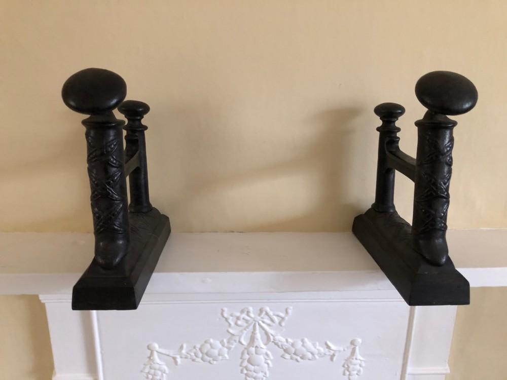 pair of arts crafts cast iron andirons