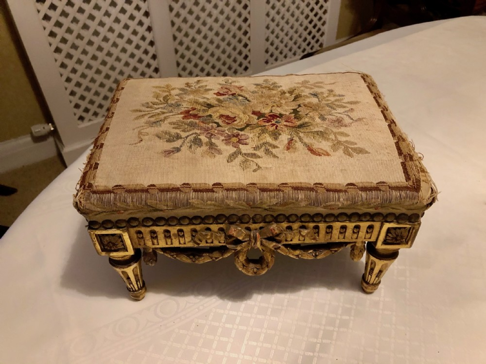 a carved giltwood and upholstered foot stool c 1860