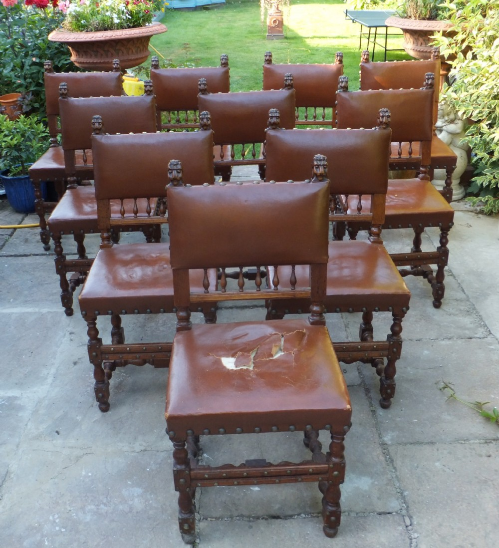 set of ten oak cromwellian leather covered dining chairs dating from the  1920's with carved lion - Dating Antique Chairs Antique Furniture