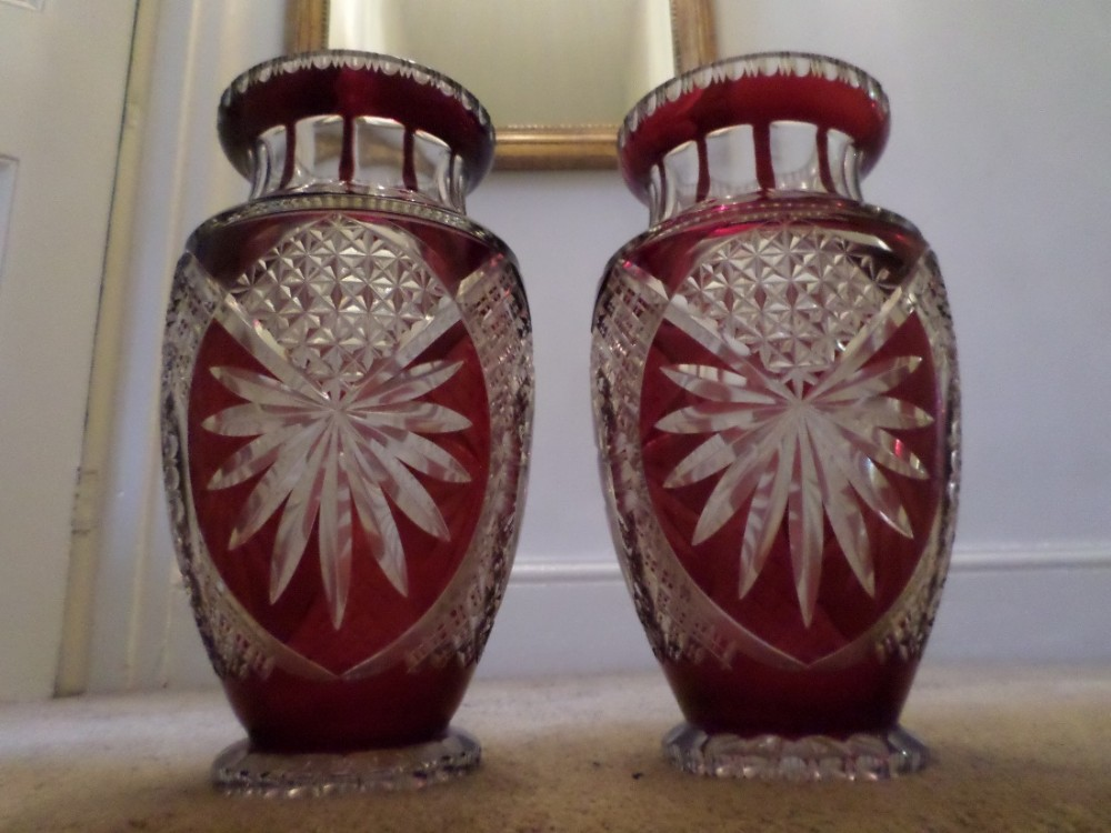 large matching pair of cut crystal vases with cranberry glass