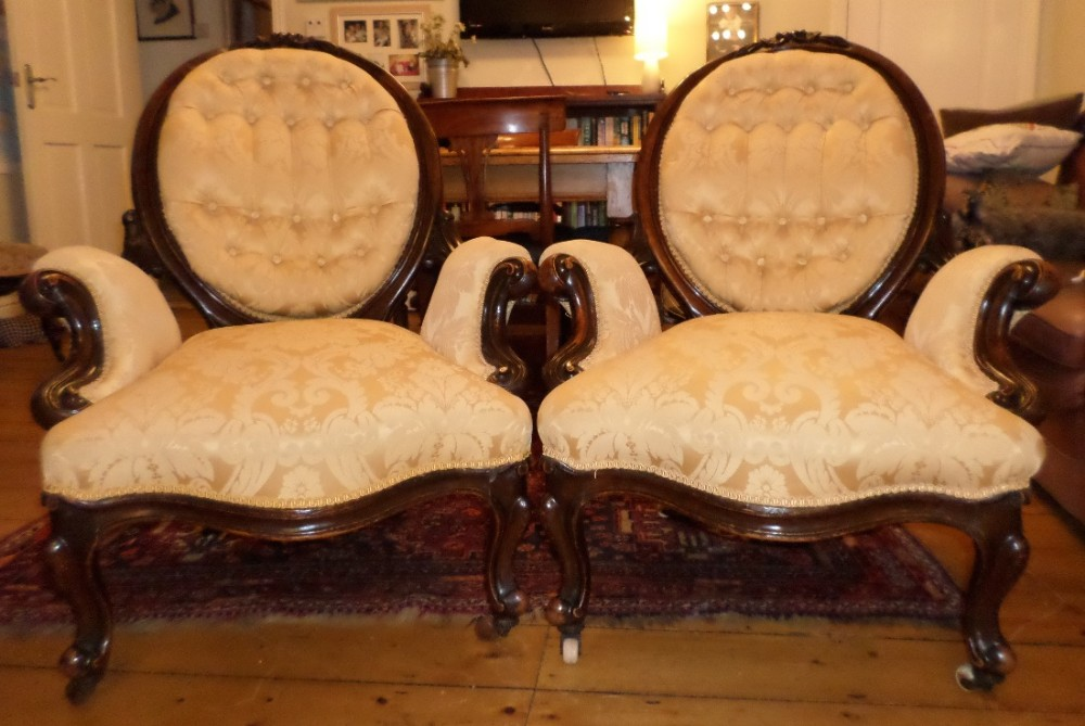 matching pair of 19th century armchairs in walnut