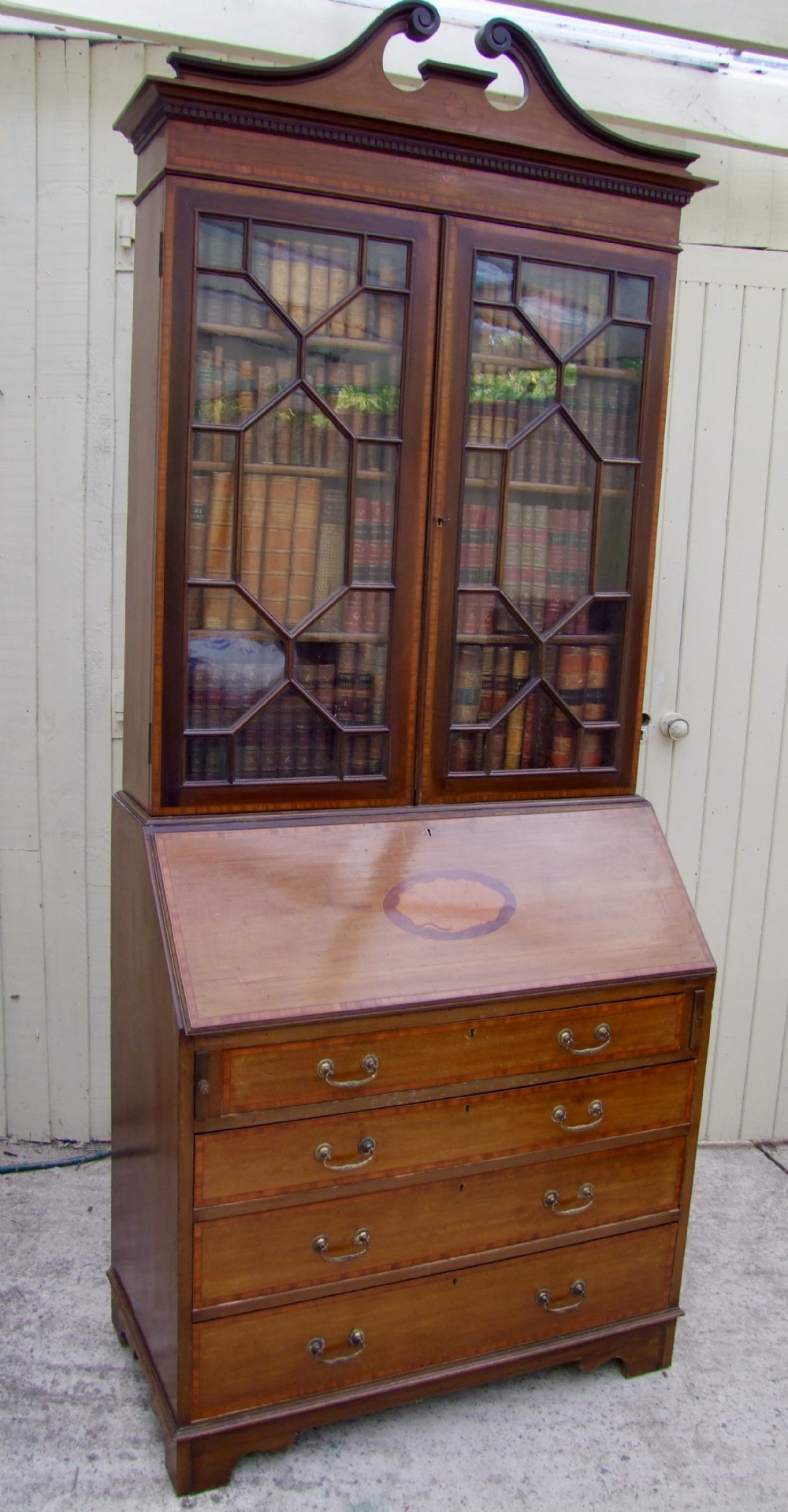 pretty late 19th century bureau bookcase in mahogany with satinwood cross banding and inlay
