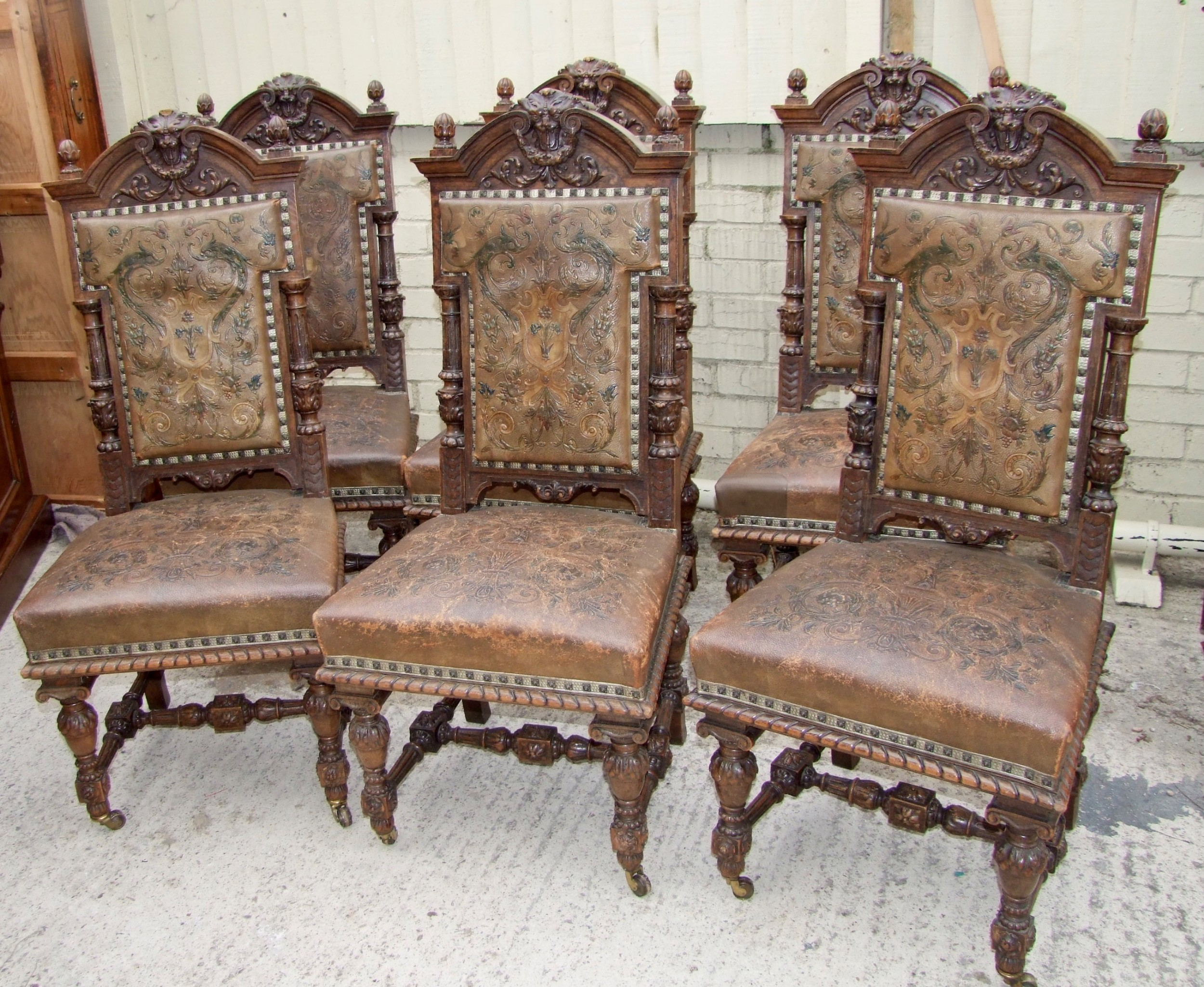 set of six 19th century carved baronial chairs with embossed leather