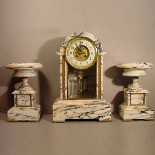a french late 19th century carrera white marble blue vein three piece fourglass clock with side tazzas