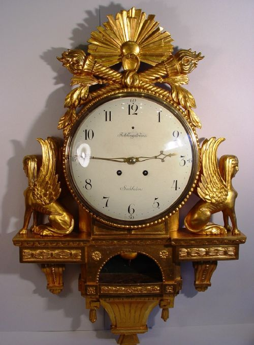 a large size swedish gustavian style gilt wood late 19th century cartel wall clock with sphinxes retailed by robert engstrom stockholm