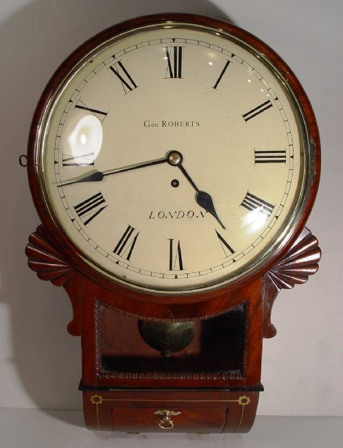 an english regency mahogany and brass inlayed fine rimmed convex dropdial wall clock by george roberts london