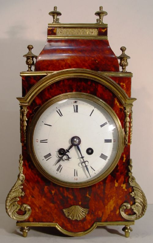 a french mid 19th cent scarlet red tortoiseshell and ormolu mounted boulle mantel clock