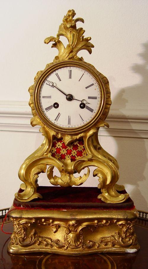 a early 19th century gilt bronze ormolu rococo mantle clock