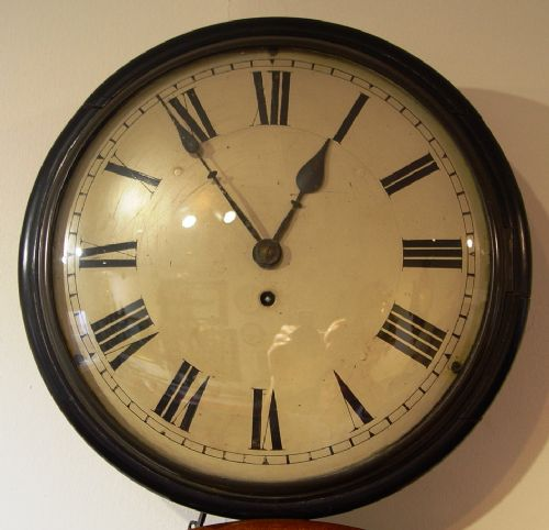 an english mid victorian ebonised mahogany 12inch convex dial clock