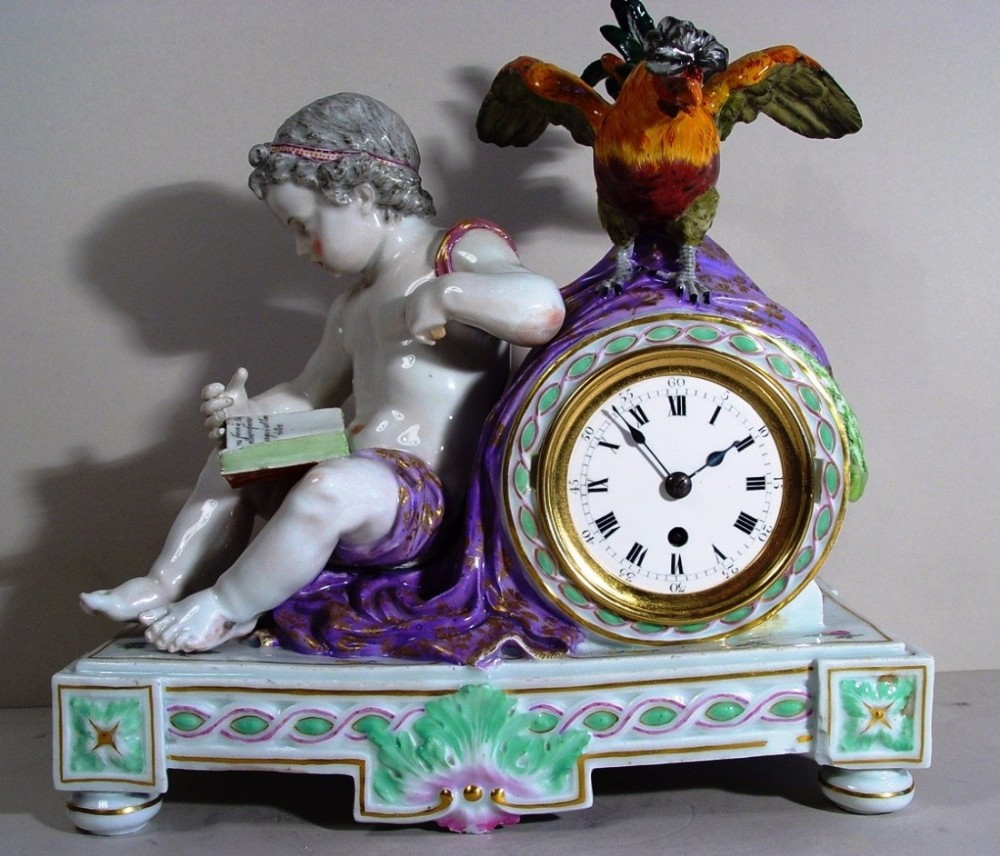 a signed french late 19th century porcelain cherub mantel clock with cockerel by meissen