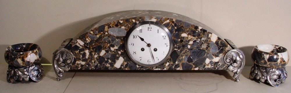 a stunning 1920s french grey breccia marble and silver plated bronze three piece clock set