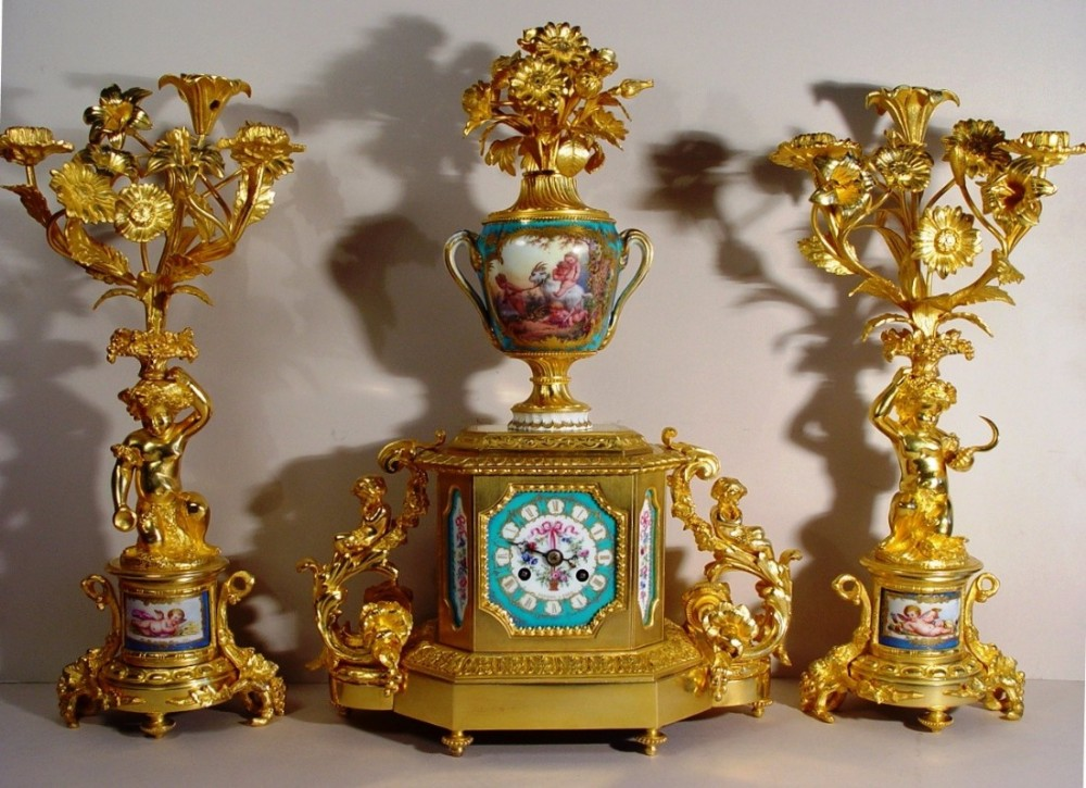 a very fine quality mid 19th century french gilt bronze and sevres porcelain clock garniture