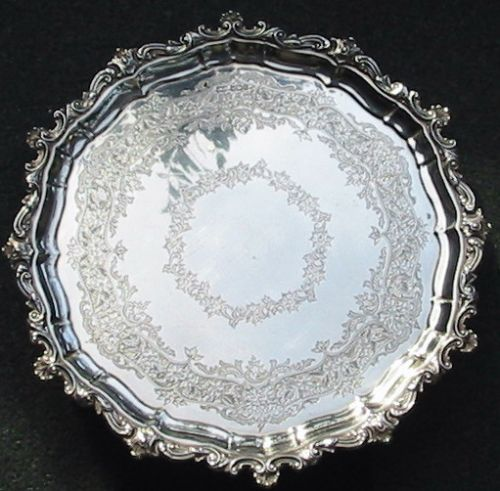 very decorative large heavy circular silver salver or drinks tray on three paw feet