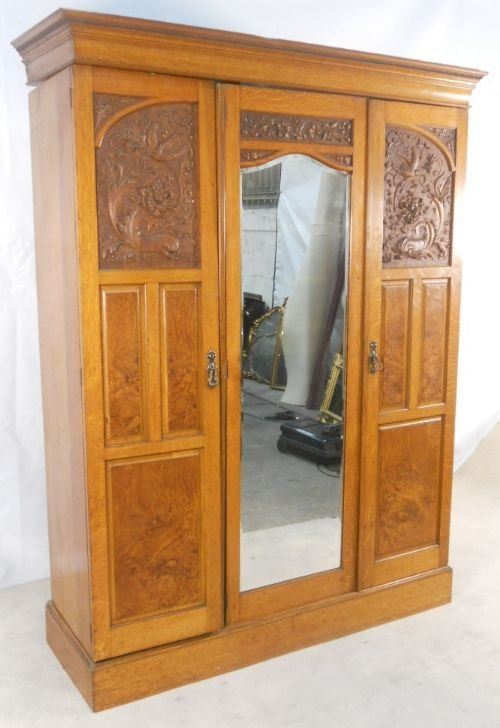 victorian carved oak panelled three door hanging wardrobe