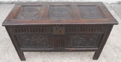 antique oak blanket chest with carved biblical scenes