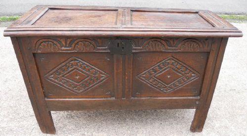 oak panelled carved front blanket chest coffer