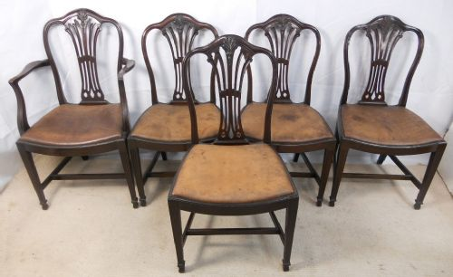 set of four single one carver georgian style mahogany dining chairs with leather seats