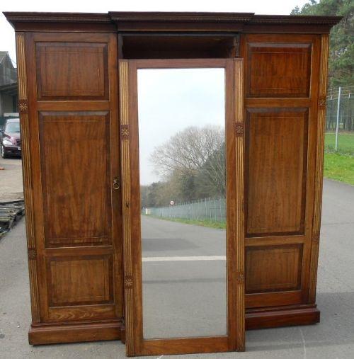 aesthetic movement large three door mahogany breakfront wardrobe