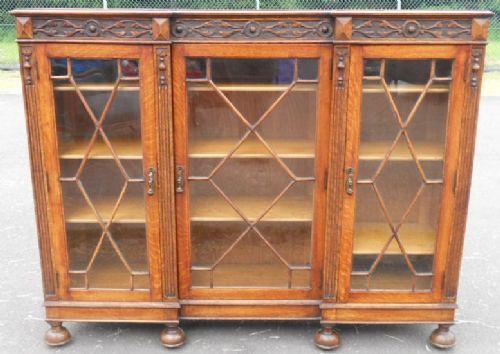 carved oak three door standing bookcase