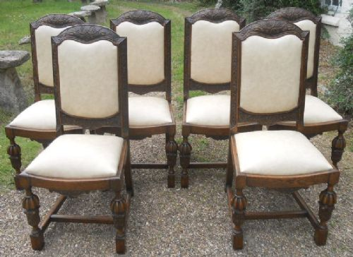 set of six carved oak highback dining chairs