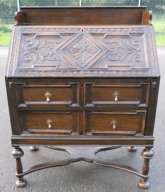 carved oak writing bureau