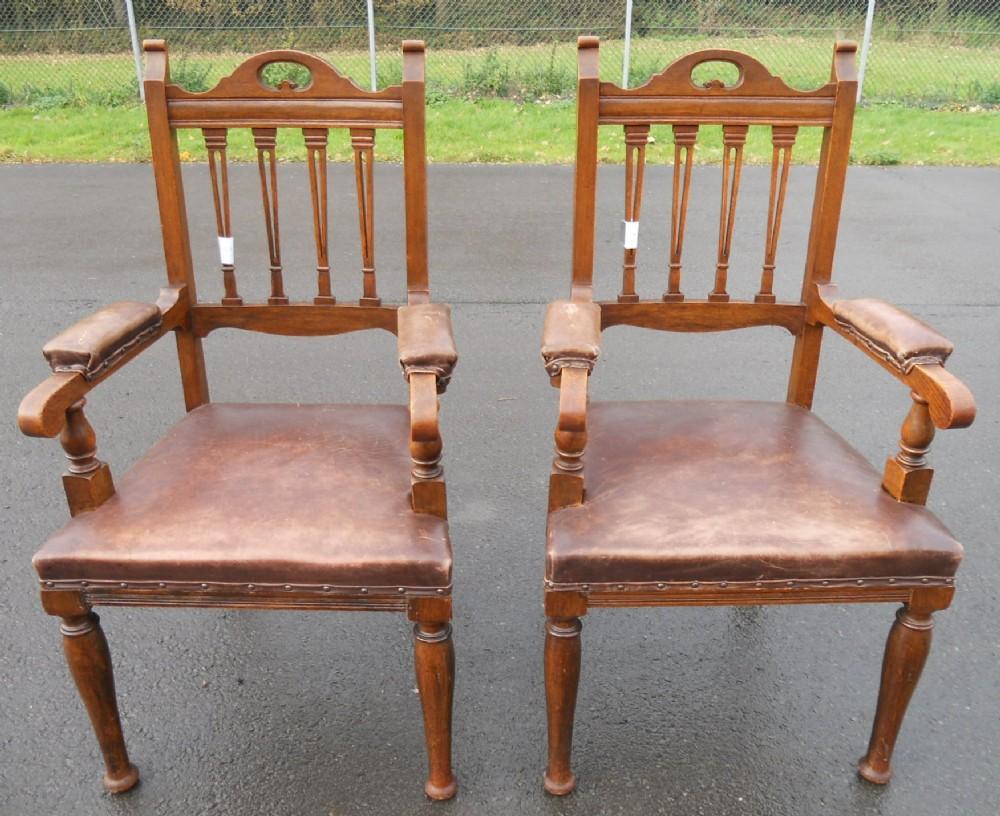 pair edwardian oak elbow armchairs