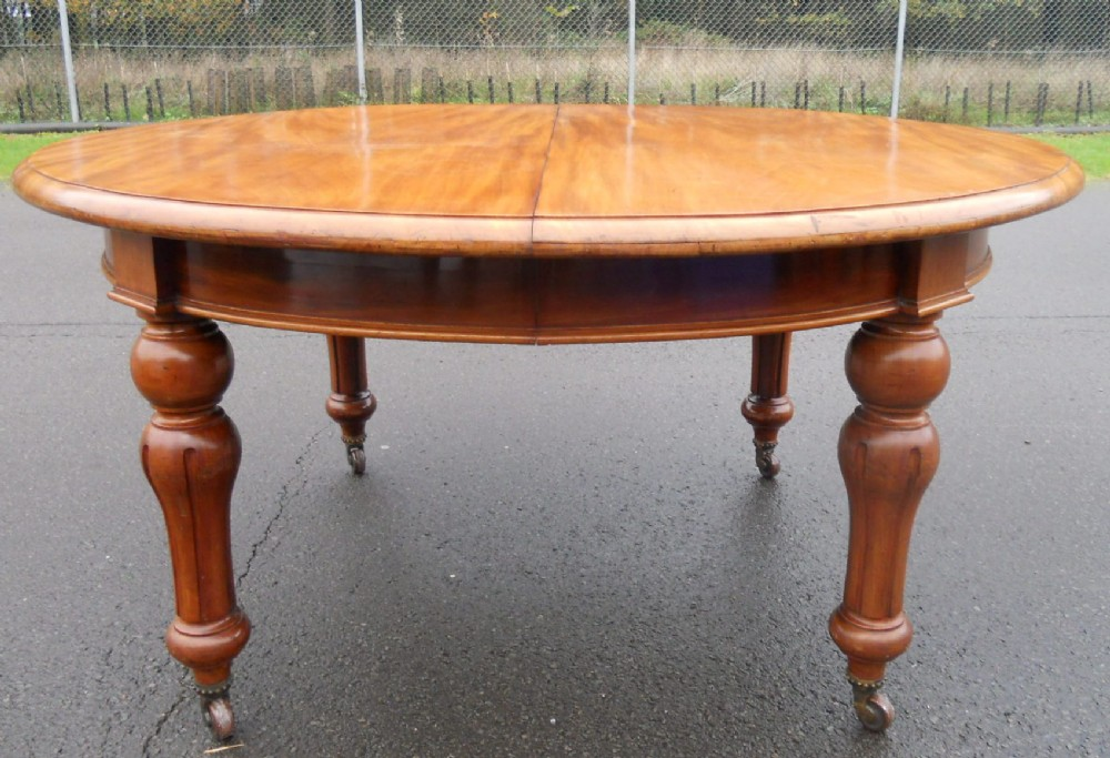victorian mahogany oval extending three leaf dining table to seat twelve