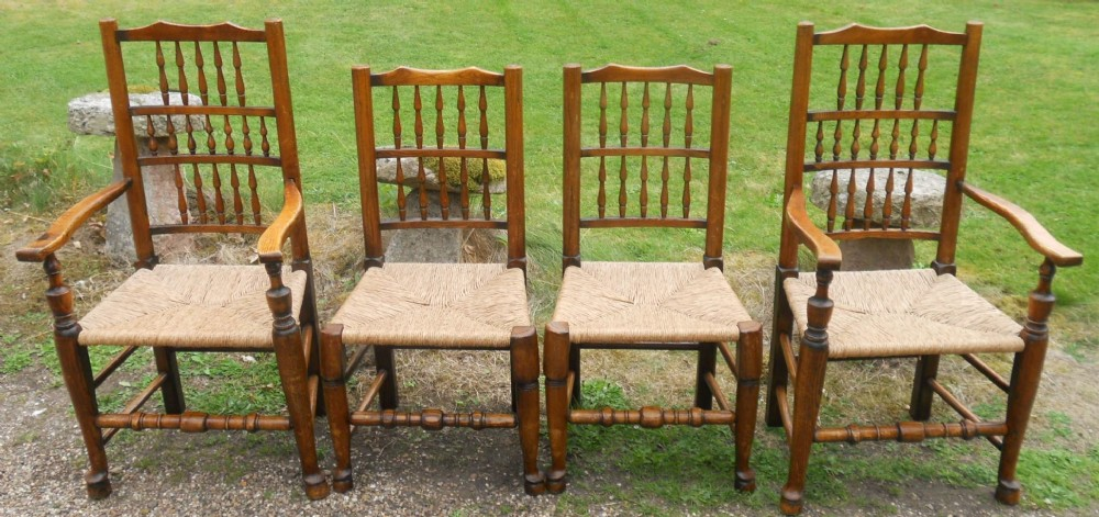 set of four lancashire style elm rush seat dining chairs