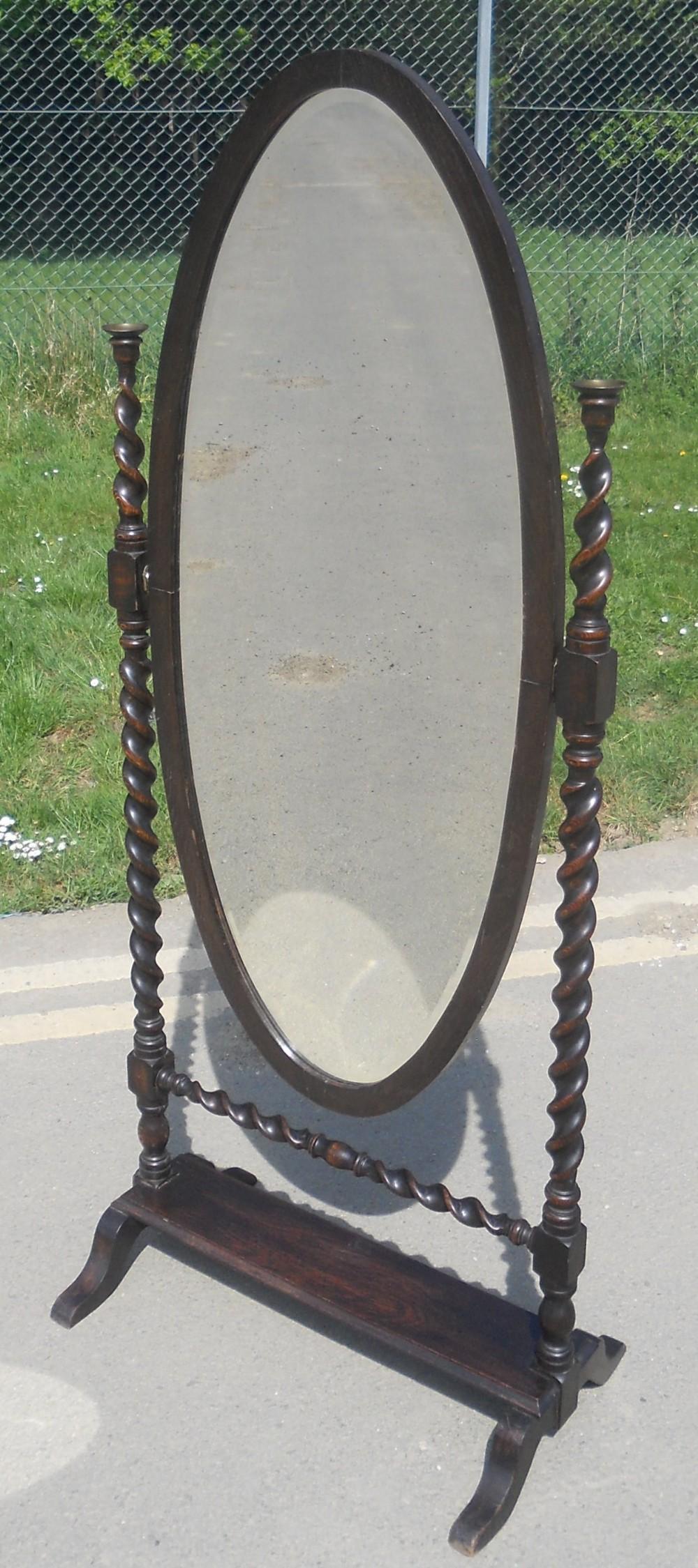 oval oak framed standing cheval mirror
