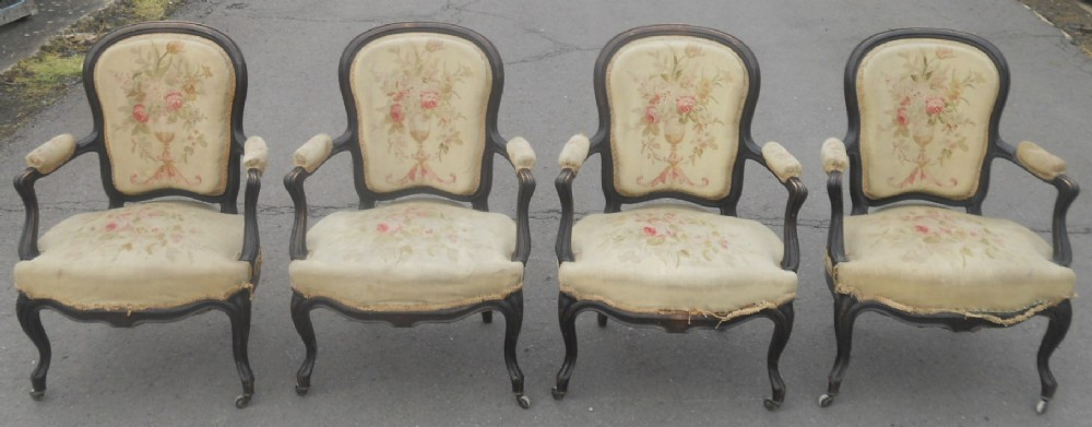 set of four victorian ebonized salon armchairs