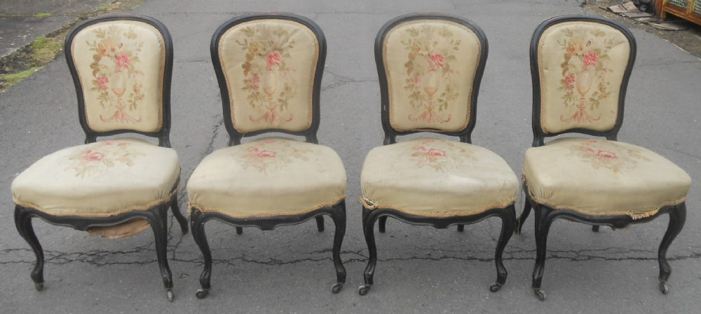 set of four victorian ebonized salon chairs