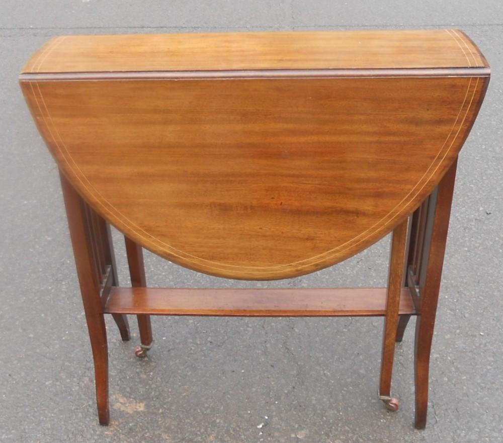 edwardian inlaid mahogany oval dropleaf coffee table
