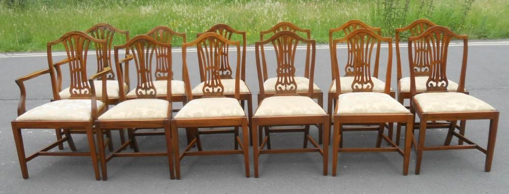 set of twelve hepplewhite style mahogany dining chairs