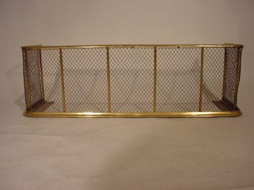 an unusual brass nursery fender