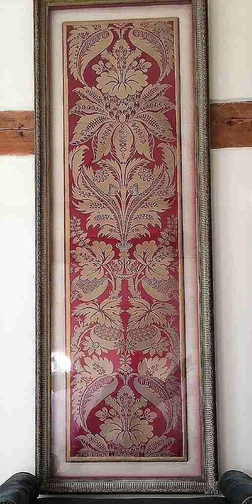 a pair of framed lengths of ornate woven satin